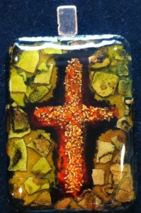 cross,orange,green,mosaic,crushed, eggshells